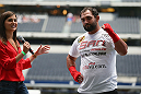 ARLINGTON, TX - AUGUST 02:  UFC fighter Johny Hendricks is interviewed during a UFC World Tour open workout ahead of a UFC Welterweight Title fight at the AT&T Stadium on August 2, 2013 in Arlington, Texas.  Georges St-Pierre and Johny Hendricks will fight on November 16 in Las Vegas, Nevada.  (Photo by Ronald Martinez/Zuffa LLC/Zuffa LLC via Getty Images)
