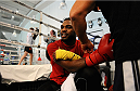 LONDON, ENGLAND - AUGUST 02:  Jon Jones removes his gloves after he trains at Stars Gym during the Jon Jones and Alex Gustafsson Press Tour on August 2, 2013 in London, England.  (Photo by Christoper Lee/Zuffa LLC/Zuffa LLC via Getty Images)