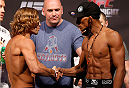 BOSTON, MA - AUGUST 16:  (L-R) Opponents Urijah Faber and Iuri Alcantara shake hands during the UFC weigh-in inside TD Garden on August 16, 2013 in Boston, Massachusetts. (Photo by Josh Hedges/Zuffa LLC/Zuffa LLC via Getty Images)
