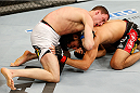 BOSTON, MA - AUGUST 17:  (L-R) James Vick secures a guillotine choke submission against Ramsey Nijem in their UFC lightweight bout at TD Garden on August 17, 2013 in Boston, Massachusetts. (Photo by Josh Hedges/Zuffa LLC/Zuffa LLC via Getty Images)