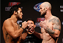 INDIANAPOLIS, IN - AUGUST 27:  (L-R) Opponents Brad Tavares and Bubba McDaniel face off during the UFC weigh-in event at Bankers Life Fieldhouse on August 27, 2013 in Indianapolis, Indiana. (Photo by Josh Hedges/Zuffa LLC/Zuffa LLC via Getty Images)