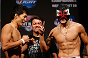 INDIANAPOLIS, IN - AUGUST 27:  (L-R) Opponents Takeya Mizugaki and Erik Perez face off during the UFC weigh-in event at Bankers Life Fieldhouse on August 27, 2013 in Indianapolis, Indiana. (Photo by Josh Hedges/Zuffa LLC/Zuffa LLC via Getty Images)