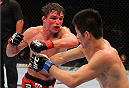 INDIANAPOLIS, IN - AUGUST 28:  (L-R) Darren Elkins punches Hatsu Hioki in their featherweight fight during the UFC on FOX Sports 1 event at Bankers Life Fieldhouse on August 28, 2013 in Indianapolis, Indiana. (Photo by Ed Mulholland/Zuffa LLC/Zuffa LLC via Getty Images)
