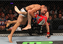 INDIANAPOLIS, IN - AUGUST 28:  (L-R) Rafael dos Anjos takes down Donald