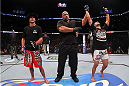 INDIANAPOLIS, IN - AUGUST 28:  Rafael dos Anjos (R) reacts after defeating Donald