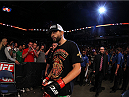 INDIANAPOLIS, IN - AUGUST 28:  Carlos Condit enters the arena before his welterweight fight against Martin Kampmann during the UFC on FOX Sports 1 event at Bankers Life Fieldhouse on August 28, 2013 in Indianapolis, Indiana. (Photo by Ed Mulholland/Zuffa LLC/Zuffa LLC via Getty Images)