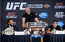 MILWAUKEE, WI - AUGUST 29:  UFC President Dana White (C) introduces Benson 'Smooth' Henderson (L) and Anthony 'Showtime' Pettis (R) during a UFC press conference at the BMO Harris Bradley Center on August 29, 2013 in Milwaukee, Wisconsin. (Photo by Jeff Bottari/Zuffa LLC/Zuffa LLC via Getty Images)