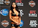 MILWAUKEE, WI - AUGUST 30:  UFC Octagon Girl Arianny Celeste stands on stage during the UFC weigh-in inside the BMO Harris Bradley Center on August 30, 2013 in Milwaukee, Wisconsin. (Photo by Jeff Bottari/Zuffa LLC/Zuffa LLC via Getty Images) *** Local Caption *** Arianny Celeste