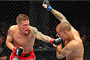 MILWAUKEE, WI - AUGUST 31:  (L-R) Erik Koch punches Dustin Poirier in their UFC featherweight bout at BMO Harris Bradley Center on August 31, 2013 in Milwaukee, Wisconsin. (Photo by Ed Mulholland/Zuffa LLC/Zuffa LLC via Getty Images) *** Local Caption *** Erik Koch; Dustin Poirier