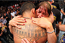MILWAUKEE, WI - AUGUST 31:  Anthony Pettis celebrates with his mother Annette Garcia after receiving the lightweight championship belt after defeating Benson Henderson in their UFC lightweight championship bout at BMO Harris Bradley Center on August 31, 2013 in Milwaukee, Wisconsin. (Photo by Ed Mulholland/Zuffa LLC/Zuffa LLC via Getty Images) *** Local Caption *** Anthony Pettis; Anette Garcia
