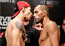BELO HORIZONTE, BRAZIL - SEPTEMBER 03:  (L-R) Opponents Lucas Martins and Junior Hernandez face off during the UFC weigh-in event at Mineirinho Arena on September 3, 2013 in Belo Horizonte, Brazil. (Photo by Josh Hedges/Zuffa LLC/Zuffa LLC via Getty Images)