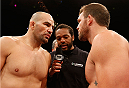 BELO HORIZONTE, BRAZIL - SEPTEMBER 04:  (L-R) Opponents Glover Teixeira and Ryan Bader face off before their light heavyweight fight during the UFC on FOX Sports 1 event at Mineirinho Arena on September 4, 2013 in Belo Horizonte, Brazil. (Photo by Josh Hedges/Zuffa LLC/Zuffa LLC via Getty Images)