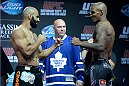 TORONTO, CANADA - SEPTEMBER 20:  (L-R) Costa Philippou and Francis Carmont face off during the UFC 165 weigh-in at the Maple Leaf Square on September 20, 2013 in Toronto, Ontario, Canada. (Photo by Jeff Bottari/Zuffa LLC/Zuffa LLC via Getty Images)