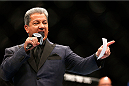 TORONTO, CANADA - SEPTEMBER 21:  UFC Octagon announcer Bruce Buffer introduces Nandor Guelmino and Daniel Omielanczuk in their UFC heavyweight bout at the Air Canada Center on September 21, 2013 in Toronto, Ontario, Canada. (Photo by Josh Hedges/Zuffa LLC/Zuffa LLC via Getty Images) *** Local Caption *** Bruce Buffer