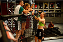 LAS VEGAS, NV - JUNE 12:  (L-R) Team Rousey trainer Edmond Tarverdyan and Coach Ronda Rousey speak to Jessica Rakoczy in her corner before her bout against Roxanne Modafferi (not pictured) in their preliminary fight during filming of season eighteen of The Ultimate Fighter on June 12, 2013 in Las Vegas, Nevada. (Photo by Al Powers/Zuffa LLC/Zuffa LLC via Getty Images) *** Local Caption *** Ronda Rousey; Edmond Tarverdyan; Jessica Rakoczy
