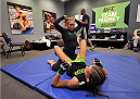LAS VEGAS, NV - JUNE 17:  (L-R) Coach Ronda Rousey trains with Jessamyn Duke before her preliminary fight against Raquel Pennington (not pictured) during filming of season eighteen of The Ultimate Fighter on June 17, 2013 in Las Vegas, Nevada. (Photo by Jeff Bottari/Zuffa LLC/Zuffa LLC via Getty Images) *** Local Caption *** Jessamyn Duke; Ronda Rousey