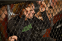 LAS VEGAS, NV - JUNE 17:  Coach Ronda Rousey watches Raquel Pennington fight Jessamyn Duke (not pictured) in their preliminary fight during filming of season eighteen of The Ultimate Fighter on June 17, 2013 in Las Vegas, Nevada. (Photo by Jeff Bottari/Zuffa LLC/Zuffa LLC via Getty Images) *** Local Caption *** Ronda Rousey