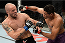 BARUERI, BRAZIL - OCTOBER 9:  (R-L) Ildemar Alcantara punches Igor Araujo in their welterweight bout during the UFC Fight Night event at the Ginasio Jose Correa on October 9, 2013 in Barueri, Sao Paulo, Brazil. (Photo by Jeff Bottari/Zuffa LLC/Zuffa LLC via Getty Images)