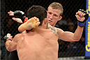 BARUERI, BRAZIL - OCTOBER 9:  (R-L) TJ Dillashaw kicks Raphael Assuncao in their bantamweight bout during the UFC Fight Night event at the Ginasio Jose Correa on October 9, 2013 in Barueri, Sao Paulo, Brazil. (Photo by Jeff Bottari/Zuffa LLC/Zuffa LLC via Getty Images)