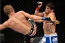 BARUERI, BRAZIL - OCTOBER 9:  (L-R) TJ Dillashaw kicks Raphael Assuncao in their bantamweight bout during the UFC Fight Night event at the Ginasio Jose Correa on October 9, 2013 in Barueri, Sao Paulo, Brazil. (Photo by Jeff Bottari/Zuffa LLC/Zuffa LLC via Getty Images)