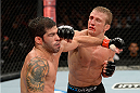 BARUERI, BRAZIL - OCTOBER 9:  (R-L) TJ Dillashaw punches Raphael Assuncao in their bantamweight bout during the UFC Fight Night event at the Ginasio Jose Correa on October 9, 2013 in Barueri, Sao Paulo, Brazil. (Photo by Jeff Bottari/Zuffa LLC/Zuffa LLC via Getty Images)
