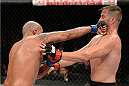 BARUERI, BRAZIL - OCTOBER 9:  (L-R) Joey Beltran punches Fabio Maldonado in their light heavyweight bout during the UFC Fight Night event at the Ginasio Jose Correa on October 9, 2013 in Barueri, Sao Paulo, Brazil. (Photo by Jeff Bottari/Zuffa LLC/Zuffa LLC via Getty Images)