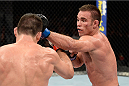 BARUERI, BRAZIL - OCTOBER 9:  (R-L) Jake Shields punches Demian Maia in their welterweight bout during the UFC Fight Night event at the Ginasio Jose Correa on October 9, 2013 in Barueri, Sao Paulo, Brazil. (Photo by Jeff Bottari/Zuffa LLC/Zuffa LLC via Getty Images)