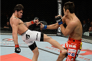 BARUERI, BRAZIL - OCTOBER 9:  (L-R) Erick Silva kicks Dong Hyun Kim in their welterweight bout during the UFC Fight Night event at the Ginasio Jose Correa on October 9, 2013 in Barueri, Sao Paulo, Brazil. (Photo by Jeff Bottari/Zuffa LLC/Zuffa LLC via Getty Images)