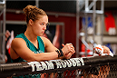 LAS VEGAS, NV - JUNE 19:  Coach Ronda Rousey stands in the corner of Michael Wooten (not pictured) before his preliminary fight against Josh Hill (not pictured) during filming of season eighteen of The Ultimate Fighter on June 19, 2013 in Las Vegas, Nevada. (Photo by Josh Hedges/Zuffa LLC/Zuffa LLC via Getty Images) *** Local Caption *** Ronda Rousey