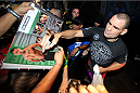 HOUSTON, TX - OCTOBER 16:  UFC Heavyweight Champion Cain Velasquez signs autographs for fans inside House of Blues on October 16, 2013 in Houston, Texas. (Photo by Jeff Bottari/Zuffa LLC/Zuffa LLC via Getty Images) *** Local Caption *** Cain Velasquez