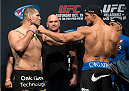 HOUSTON, TX - OCTOBER 18:  (L-R) UFC heavyweight champion Cain Velasquez and Junior Dos Santos face off during the UFC 166 weigh-in at the Toyota Center on October 18, 2013 in Houston, Texas. (Photo by Jeff Bottari/Zuffa LLC/Zuffa LLC via Getty Images) *** Local Caption *** Cain Velasquez; Junior Dos Santos
