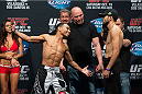HOUSTON, TX - OCTOBER 18:  (L-R) John Dodson and Darrell Montage face off during the UFC 166 weigh-in at the Toyota Center on October 18, 2013 in Houston, Texas. (Photo by Jeff Bottari/Zuffa LLC/Zuffa LLC via Getty Images) *** Local Caption *** John Dodson; Darrell Montague