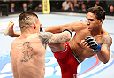 HOUSTON, TEXAS - OCTOBER 19:  (R-L) Andre Fili kicks Jeremy Larsen in their UFC featherweight bout at the Toyota Center on October 19, 2013 in Houston, Texas. (Photo by Nick Laham/Zuffa LLC/Zuffa LLC via Getty Images)