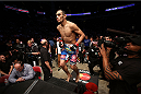 HOUSTON, TEXAS - OCTOBER 19:  Tony Ferguson enters the Octagon before facing Mike Rio (not pictured) in their UFC lightweight bout at the Toyota Center on October 19, 2013 in Houston, Texas. (Photo by Nick Laham/Zuffa LLC/Zuffa LLC via Getty Images)