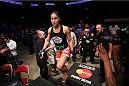 HOUSTON, TEXAS - OCTOBER 19:  Jessica Eye enters the Octagon before facing Sarah Kaufman (not pictured) in their UFC women's bantamweight bout at the Toyota Center on October 19, 2013 in Houston, Texas. (Photo by Nick Laham/Zuffa LLC/Zuffa LLC via Getty Images)