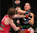HOUSTON, TEXAS - OCTOBER 19:  (R-L) Jessica Eye blocks a punch from Sarah Kaufman in their UFC women's bantamweight bout at the Toyota Center on October 19, 2013 in Houston, Texas. (Photo by Nick Laham/Zuffa LLC/Zuffa LLC via Getty Images)