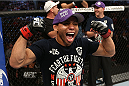 HOUSTON, TEXAS - OCTOBER 19:  John Dodson celebrates after defeating Darrell Montague (not pictured) by knockout in their UFC flyweight bout at the Toyota Center on October 19, 2013 in Houston, Texas. (Photo by Nick Laham/Zuffa LLC/Zuffa LLC via Getty Images)