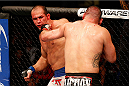 HOUSTON, TEXAS - OCTOBER 19:  (R-L) Cain Velasquez punches Junior Dos Santos in their UFC heavyweight championship bout at the Toyota Center on October 19, 2013 in Houston, Texas. (Photo by Josh Hedges/Zuffa LLC/Zuffa LLC via Getty Images)