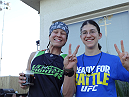 Shayna Baszler and Roxanne Modafferi offer up big smiles and peace to all.
