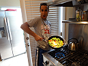 Anthony Gutierrez whips up some veggies for the rest of the gang.