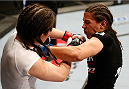 MANCHESTER, ENGLAND - OCTOBER 26:  (R-L) Jessica Andrade punches Rosi Sexton in their women's bantamweight bout during the UFC Fight Night event at Phones 4 U Arena on October 26, 2013 in Manchester, England. (Photo by Josh Hedges/Zuffa LLC/Zuffa LLC via Getty Images)