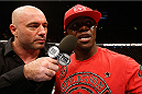 MANCHESTER, ENGLAND - OCTOBER 26:  (R-L) Melvin Guillard is interviewed by Joe Rogan after his lightweight bout against Ross Pearson during the UFC Fight Night event at Phones 4 U Arena on October 26, 2013 in Manchester, England. (Photo by Josh Hedges/Zuffa LLC/Zuffa LLC via Getty Images)