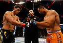 MANCHESTER, ENGLAND - OCTOBER 26:  (L-R) Opponents Lyoto Machida and Mark Munoz face off before their middleweight bout during the UFC Fight Night event at Phones 4 U Arena on October 26, 2013 in Manchester, England. (Photo by Josh Hedges/Zuffa LLC/Zuffa LLC via Getty Images)