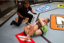 LAS VEGAS, NV - JUNE 21:  Sarah Moras (blue shorts) submits Margaret Morgan (green shorts) by arm bar in their preliminary fight during filming of season eighteen of The Ultimate Fighter on June 21, 2013 in Las Vegas, Nevada. (Photo by Josh Hedges/Zuffa LLC/Zuffa LLC via Getty Images) *** Local Caption *** Sarah Moras; Margaret Morgan