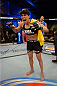 FORT CAMPBELL, KENTUCKY - NOVEMBER 6:  Amanda Nunes reacts to her victory over Germaine de Randamie in their UFC women's bantamweight bout on November 6, 2013 in Fort Campbell, Kentucky. (Photo by Jeff Bottari/Zuffa LLC/Zuffa LLC via Getty Images) *** Local Caption ***Amanda Nunes