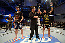 FORT CAMPBELL, KENTUCKY - NOVEMBER 6:  Francisco Rivera (right) is declared the winner against George Roop (left) in their UFC bantamweight bout on November 6, 2013 in Fort Campbell, Kentucky. (Photo by Jeff Bottari/Zuffa LLC/Zuffa LLC via Getty Images) *** Local Caption ***George Roop; Francisco Rivera