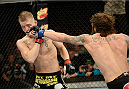 FORT CAMPBELL, KENTUCKY - NOVEMBER 6:  (R-L) Michael Chiesa punches Colton Smith in their UFC lightweight bout on November 6, 2013 in Fort Campbell, Kentucky. (Photo by Jeff Bottari/Zuffa LLC/Zuffa LLC via Getty Images) *** Local Caption ***Colton Smith; Michael Chiesa