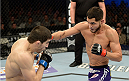 FORT CAMPBELL, KENTUCKY - NOVEMBER 6:  (R-L) Jorge Masvidal punches Rustam Khabilov in their UFC lightweight bout on November 6, 2013 in Fort Campbell, Kentucky. (Photo by Jeff Bottari/Zuffa LLC/Zuffa LLC via Getty Images) *** Local Caption ***Jorge Masvidal; Rustam Khabilov