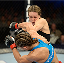 FORT CAMPBELL, KENTUCKY - NOVEMBER 6:  Alexis Davis (top) punches Liz Carmouche (bottom) in their UFC women's bantamweight bout on November 6, 2013 in Fort Campbell, Kentucky. (Photo by Jeff Bottari/Zuffa LLC/Zuffa LLC via Getty Images) *** Local Caption ***Liz Carmouche; Alexis Davis