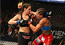 FORT CAMPBELL, KENTUCKY - NOVEMBER 6:  (L-R) Alexis Davis punches Liz Carmouche in their UFC women's bantamweight bout on November 6, 2013 in Fort Campbell, Kentucky. (Photo by Ed Mulholland/Zuffa LLC/Zuffa LLC via Getty Images) *** Local Caption ***Liz Carmouche; Alexis Davis